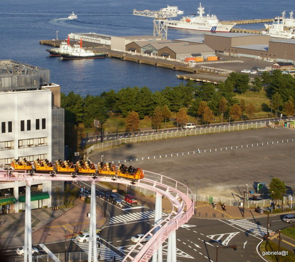 Roller coaster and a view of Yokohama port