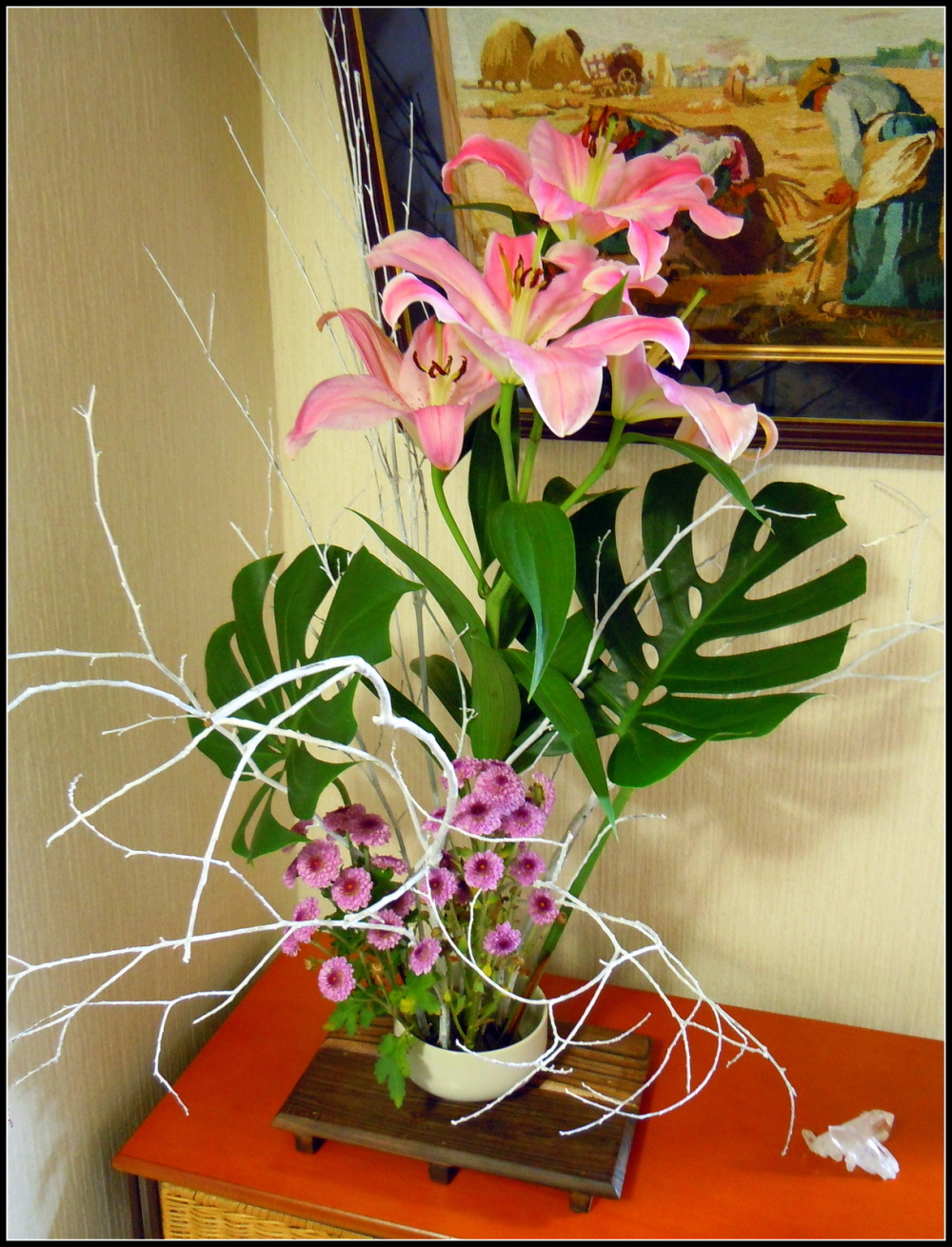 My ikebana with orietal lily and monstera leaves