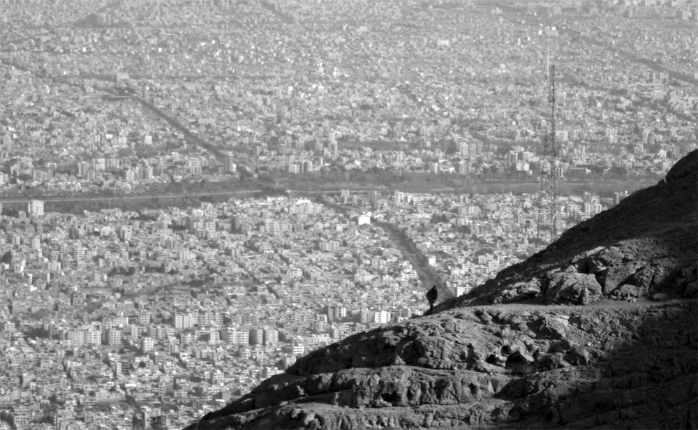 human,man,small,tiny,mountain,city,lonely