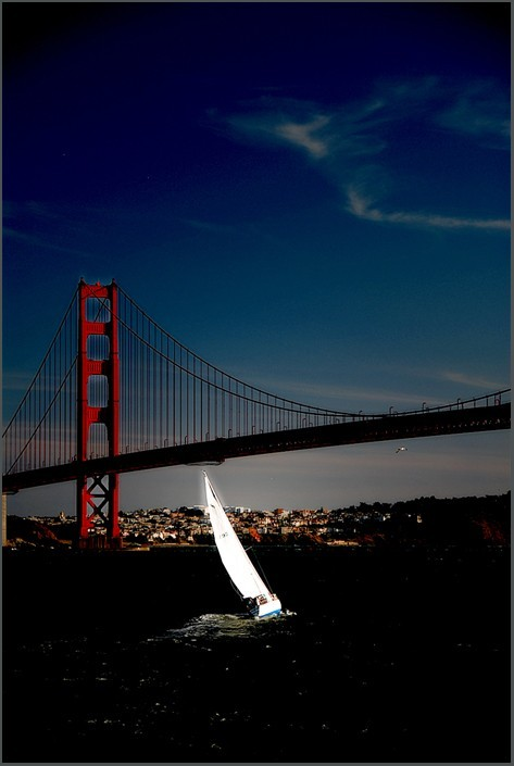 sailboat under the golden gate bridge