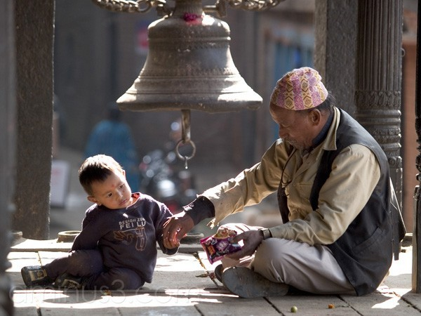 Child with grandfather on temple steps in Bhaktapu
