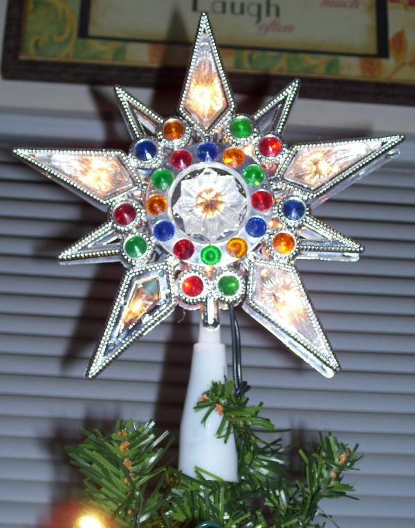 christmas star on top of tree