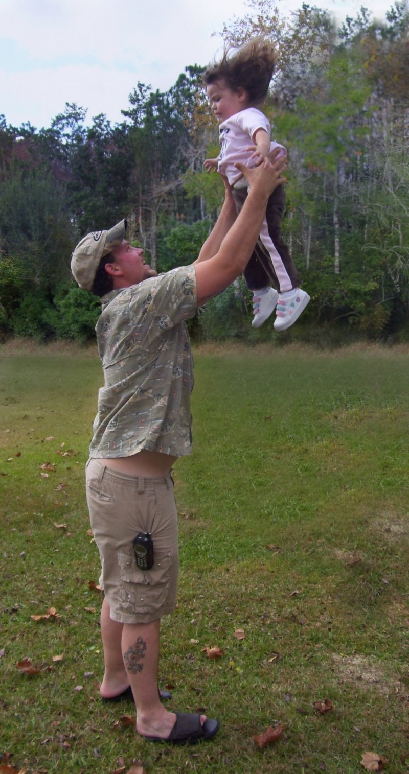 my brother throwing his girl up into the air