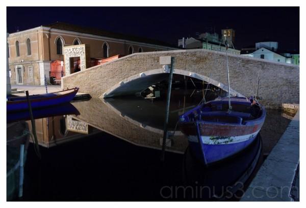 old bridge and boat blu