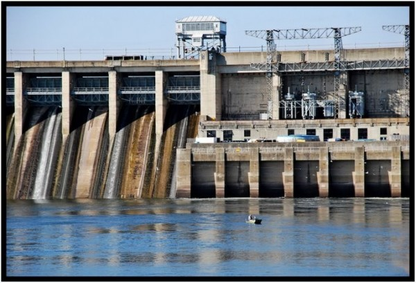 A man fishing below Bagnell Dam