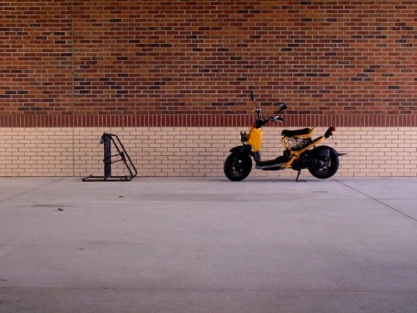 A motorcycle and a bike rack.