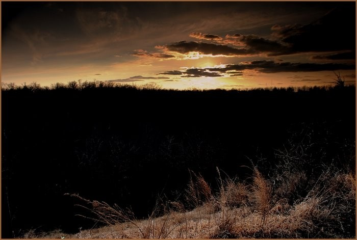 Sunset over the Ozark hills.