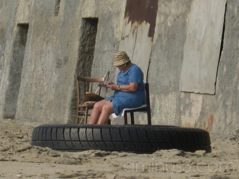 a lady standing... in an incredible big tyre?