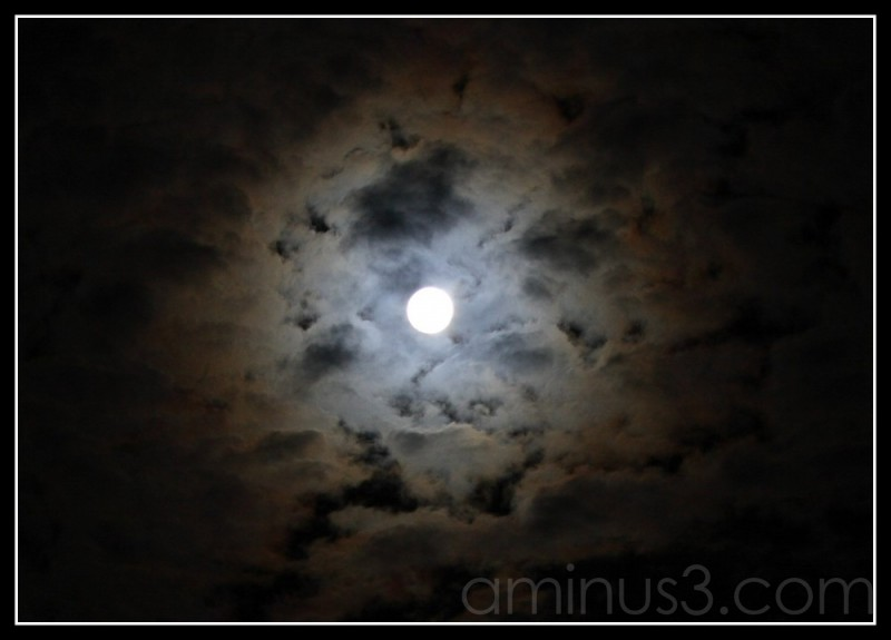 moon at night surrounded by clouds