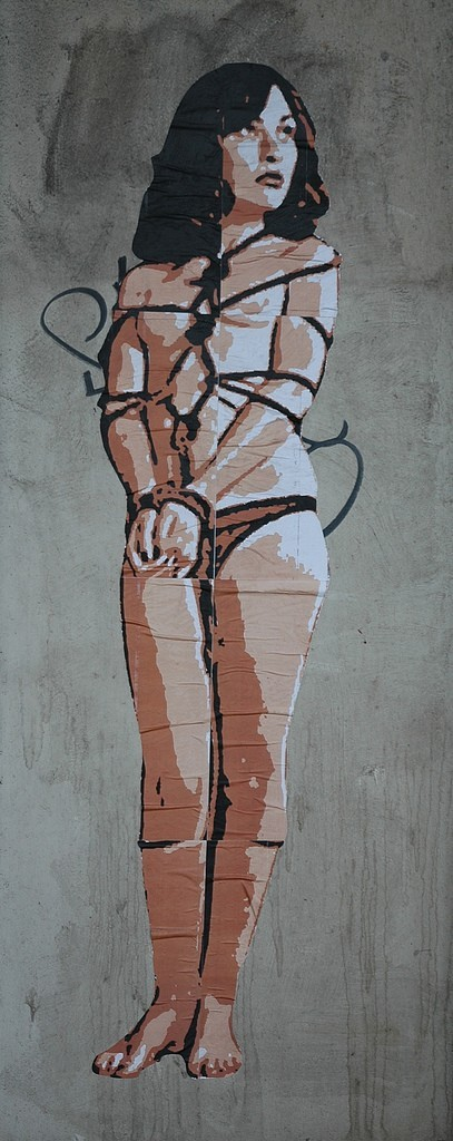 street art pasteup girl bondage safe