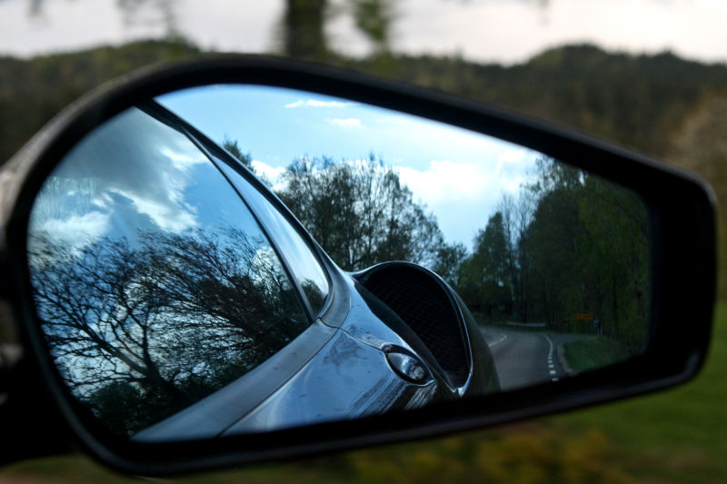 In the rear-view mirror of a Ferrari.