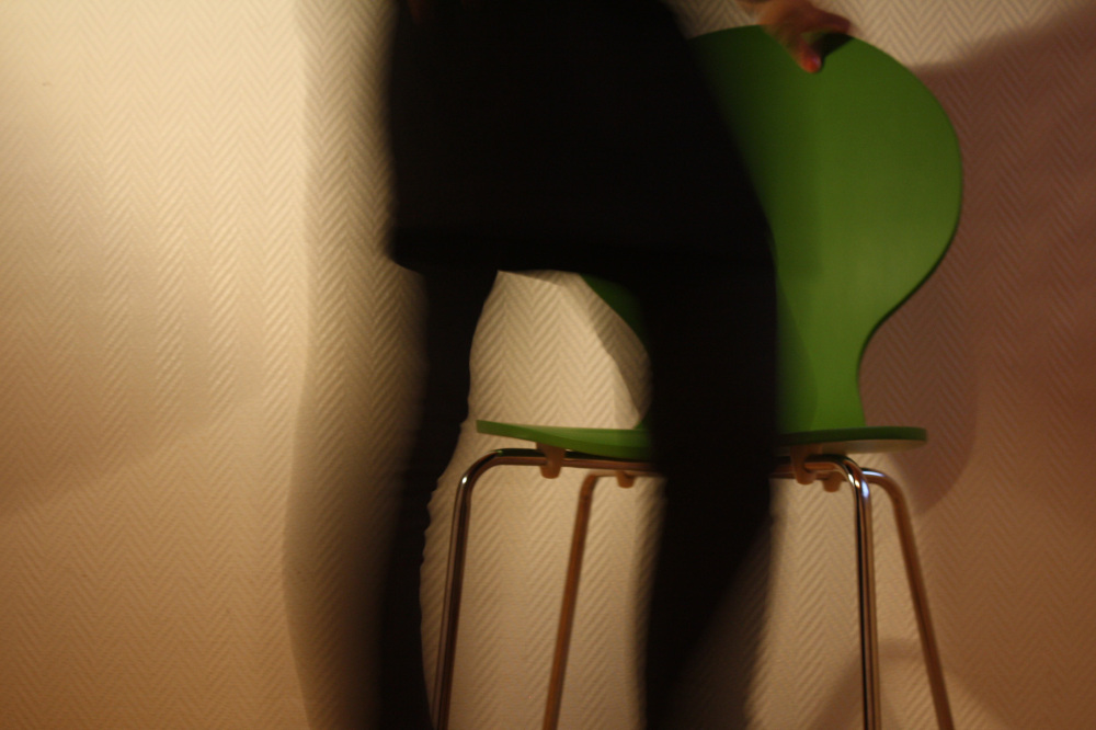 Moving towards a green chair.