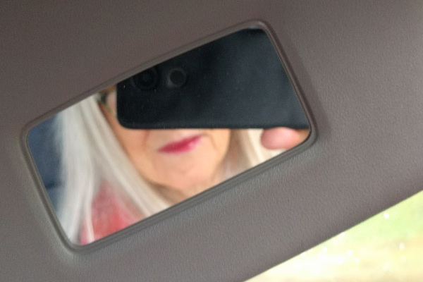 In the car.