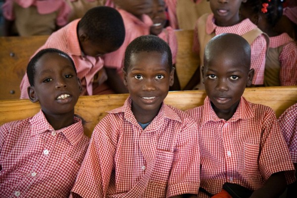 three haitian school boys sitting