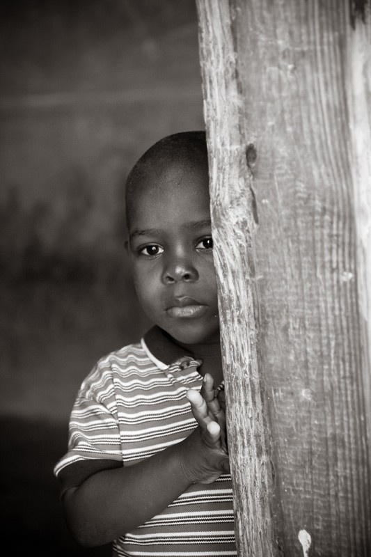 haitian school boy looking out
