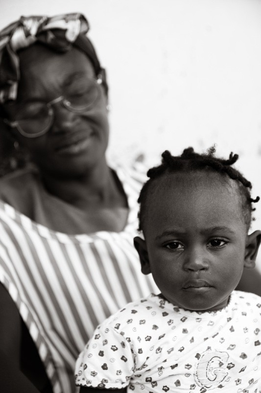 Haitian child with adoption home worker