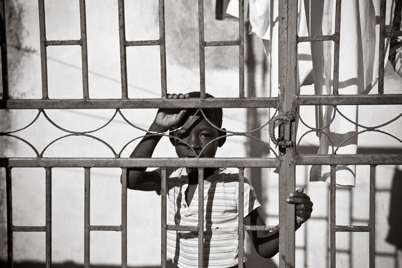 haitian boy behind bars