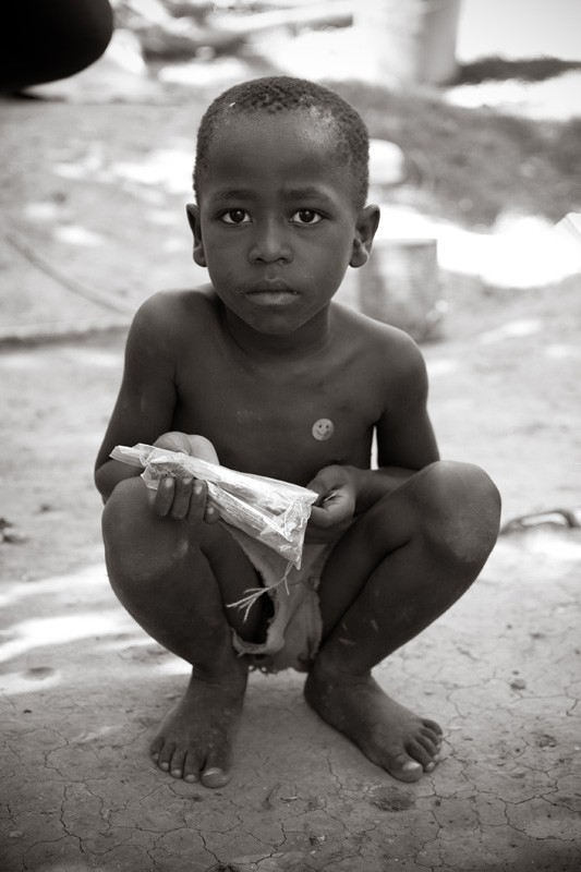 Haitian boy with candy