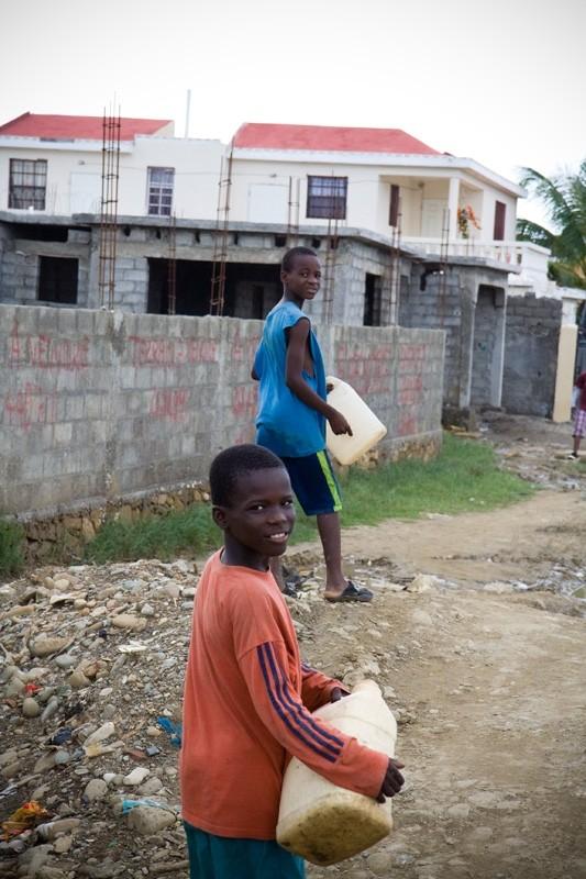 haiti boys carrying water