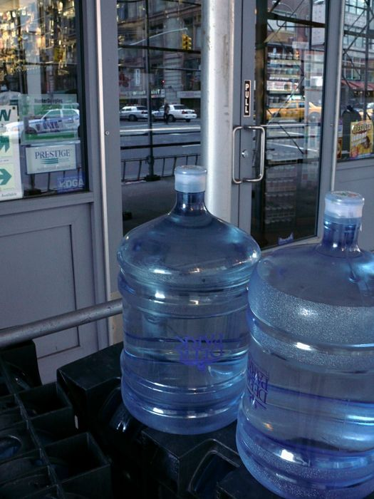 New York street storefront water cylinder