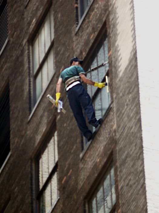 New York man window cleaner building street