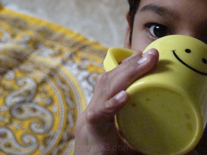 Child Drinking Coffee