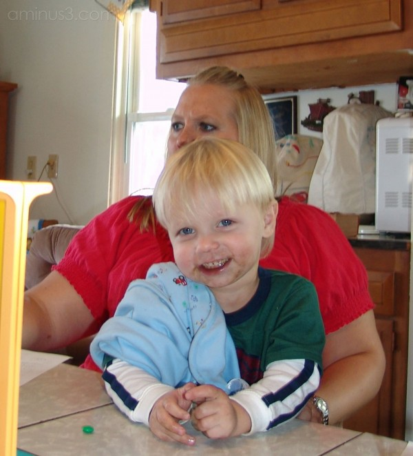 Kid sitting on mom's lap
