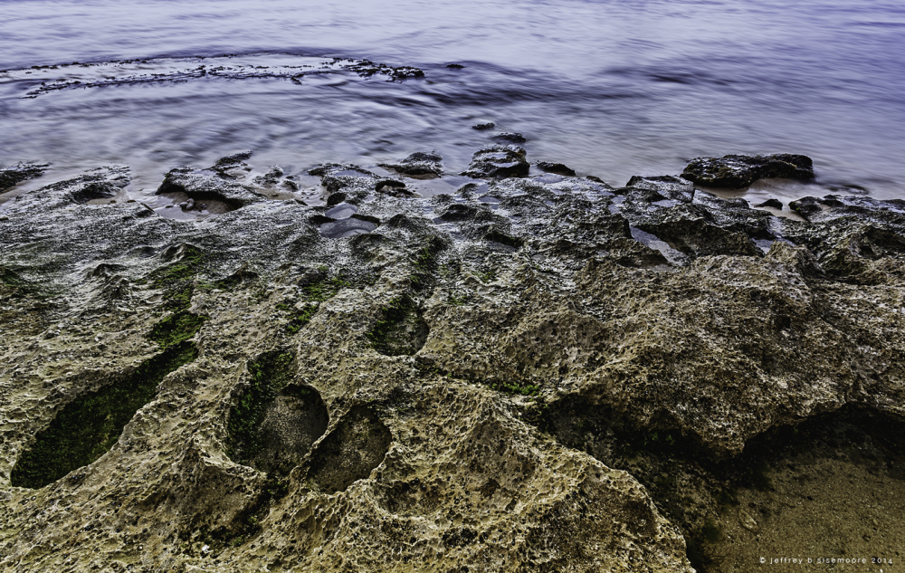 eroding rock at water's edge