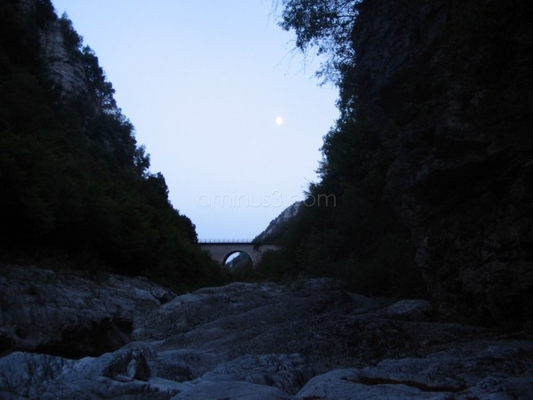 Moon over the stone bridge in Forre del Titerno
