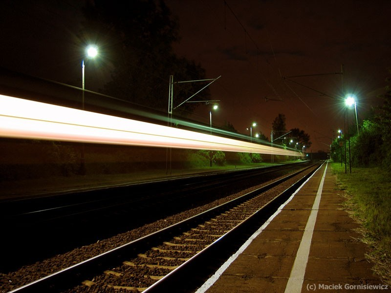 Stream of light from a passing train at night.