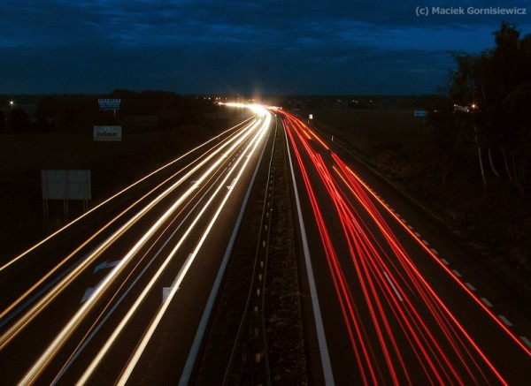 Streaks of light created by cars on a highway.