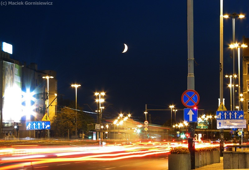 Moon sets over the city of Łódź