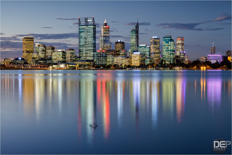 This the City of Perth skyline at dusk Anno Domini 2013...  after a long time i finally ventured out to capture the updated skyline with the new BHP Billiton building joining the line up - that's the wide building and the first on the left from the three highest skyscrapers in the middle...  you can see the previous line up [i][url=http://darkelf.aminus3.com/image/2008-05-04.html]here[/url][/i]