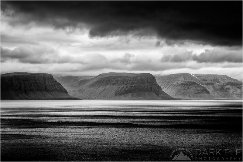 """----------------------------------------------------------------------------------------  We has a lot of what I call """"black and white weather"""" during our trip through Iceland. Rain, wind, clouds and fog were our constant companions. You get, of course, the famous effect of horizontal rain as well.  This is just about the best view of the Westfjords that we had through the rain and strong winds. I resorted to taking every single opportunity to photograph something decent and it was very frustrating at times. Still we kept going on and always hoped that a touch of good light and weather was just around the corner."""