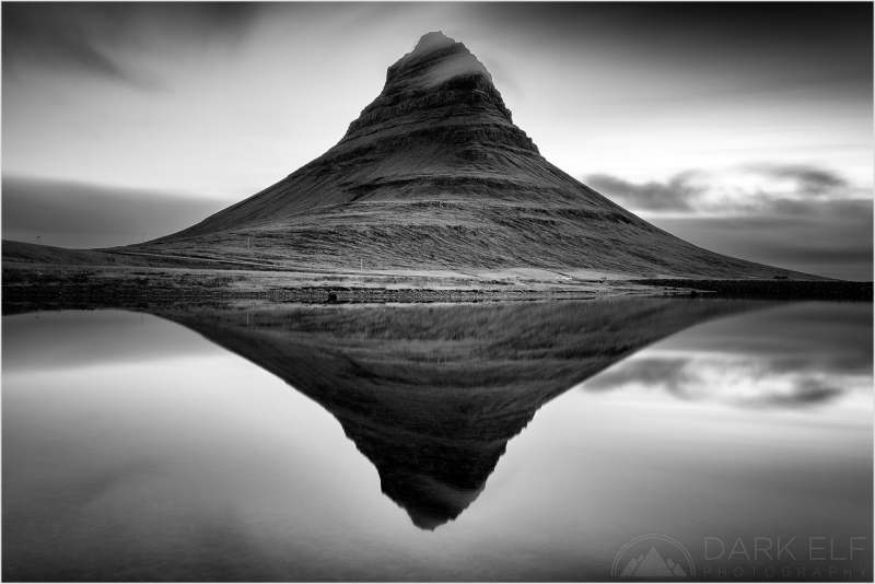 ----------------------------------------------------------------------------------------  This must be just about the most photographed place in Iceland so naturally we had to get out there and I had capture it myself as well!  It is of course Kirkjufell - The Church Mountain - near the town of Grundarfjörður on the Snæfelnelss Peninsula.  I was a lone photographer the morning this photo was taken. During the previous evening's sunset shoot there were about fifteen photographers jostling around. I was a bit surprised that no one else turned up at dawn. At least that gave me plenty of peace and space to myself.