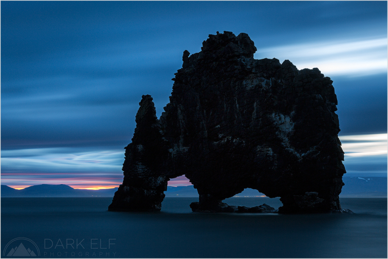 ----------------------------------------------------------------------------------------  Some call it a troll, others a dragon, in Iceland it is called Hvitserkur and I will call it The Giant. Here it is awakening during my dawn shoot on the  eastern shores of Vatnsnes peninsula.  The clouds were moving very fast and what started off as a calm morning quickly became a struggle against strong winds that arrived from the south. I do not think I have ever experienced such powerful sustained winds as on that day.  There were only glimpses of sunrise colours over the horizon but it was still fascinating to be there and to see this rock through my own eyes.  I would like to wish everyone who celebrates this time of the year a Very Merry and Peaceful Christmas!