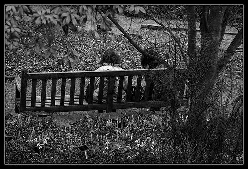 two people chatting on a bench