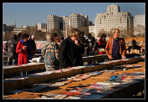 people at a secondhand book stall