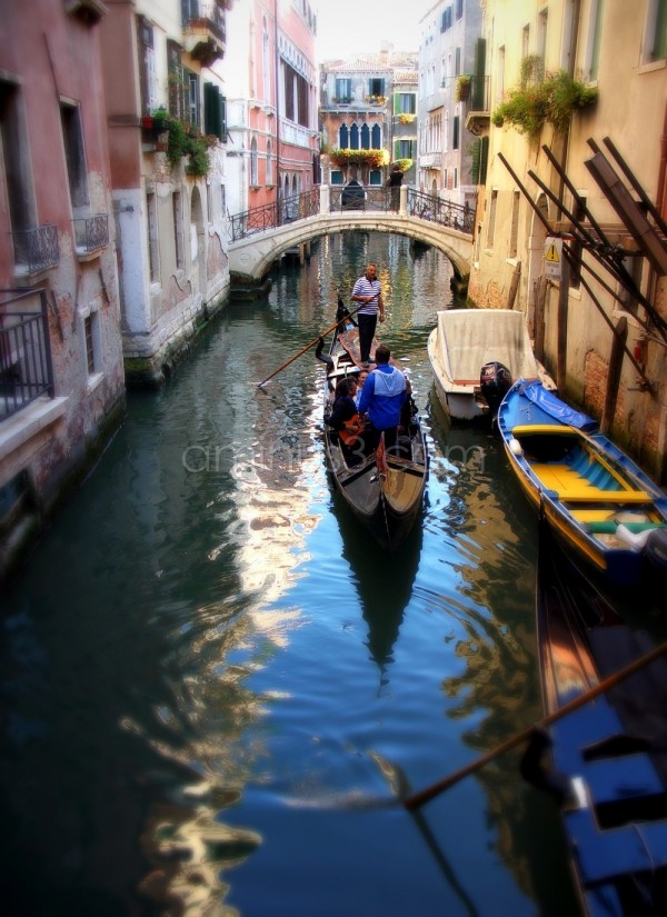 Canal and gondola in Venice Italy