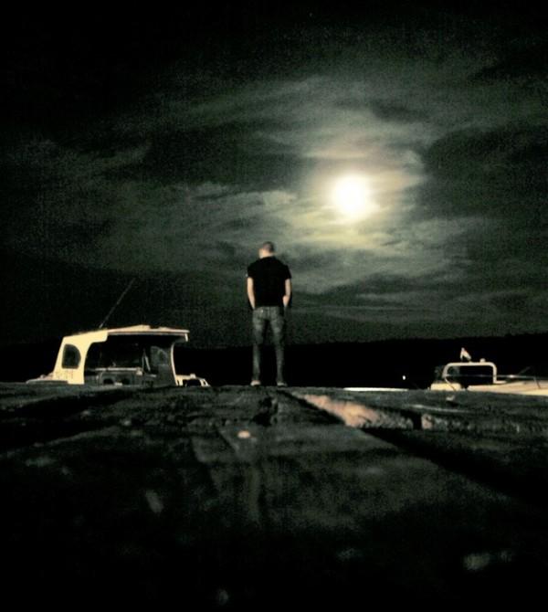 moon sea man boat