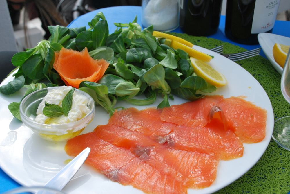 Salmon fish with salads and cheese in Catania