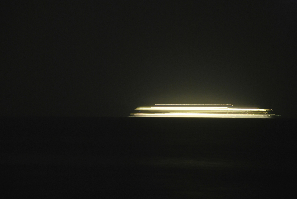 A ray of light left by a ship in the night
