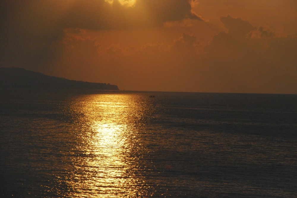 A sunset view on the Detroit of Messina, Italy