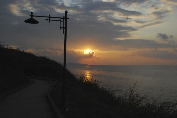 A sunset view is background to an old street lamp