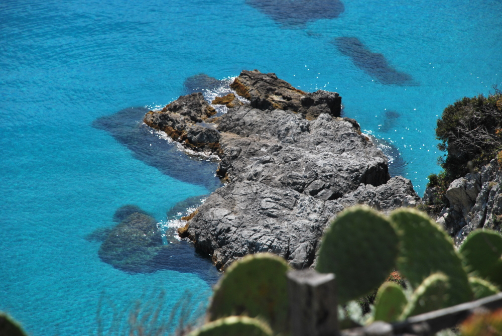 An image of a rock on the sea in Calabria, Italy