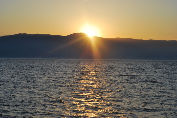 A sunset view from the detroit of Messina, Italy