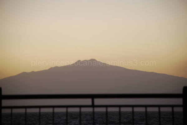 Sunset view of mount Etna as seen from mainland