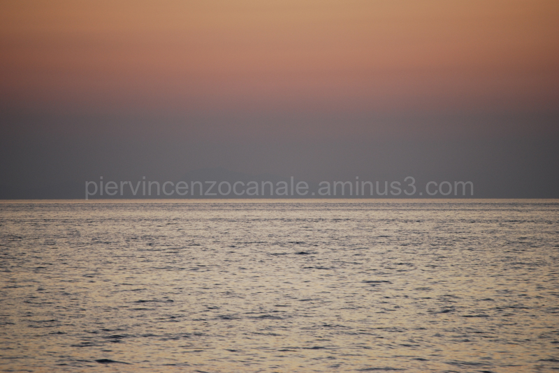 A sunset view of Sicily from Calabria, Italy.