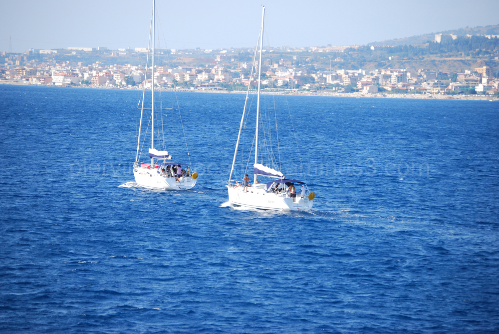 A view of two sailboats in southern Italy.