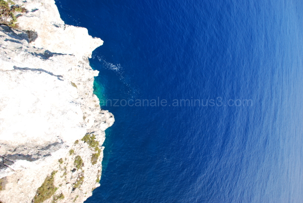 A view of the sea from Lampedusa on a rock